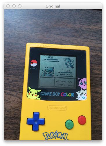 Figure 1: Our original Game Boy query image. Our goal is to find the screen in this image.