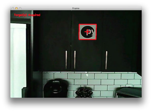 "Figure 2: Detecting a PyImageSearch logo ""target"" from my quadcopter video stream using Python and OpenCV."