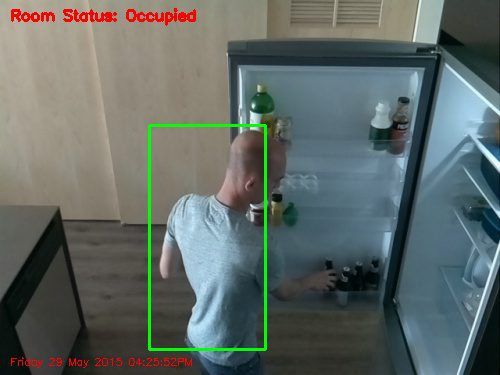 Figure 8: In this example frame captured by the Raspberry Pi camera, you can clearly see that I am reaching for a beer in the refrigerator.