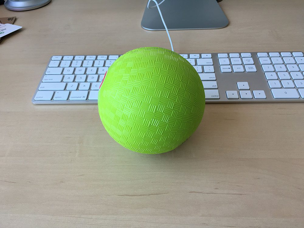 Figure 1: The green ball we will be detecting in our video stream. If the ball is found, we'll trigger an alarm by buzzing the buzzer and lighting up the green LED light.