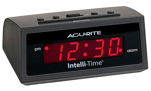 Figure 1: A classic digital alarm clock that contains four seven-segment displays to represent the time of day.