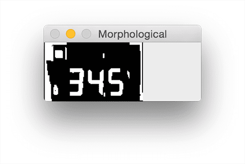 Figure 9: Applying a series of morphological operations cleans up our thresholded LCD and will allow us to segment out each of the digits.