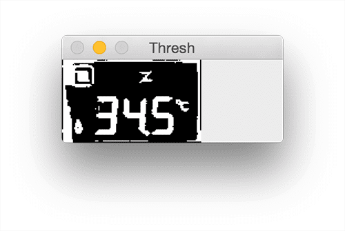 Figure 8: Thresholding LCD allows us to segment the dark regions (digits/symbols) from the lighter background (the LCD display itself).