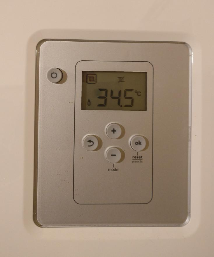 Figure 5: Our example input image. Our goal is to recognize the digits on the thermostat using OpenCV and Python.
